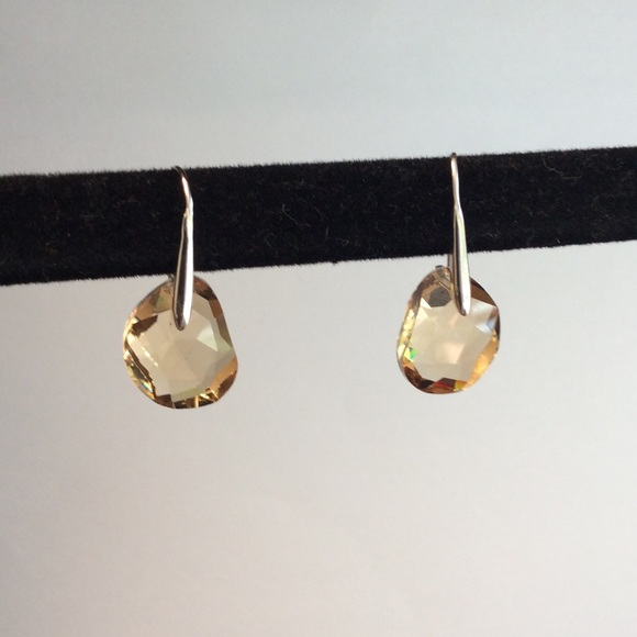 cac0193c9 Swarovski Galet Earrings in Yellow. M_55edd3757fab3aa2b201a6a3