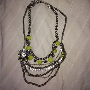 2 silver and neon yellow necklaces