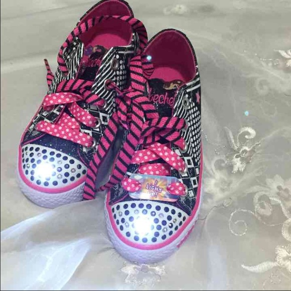 black skechers light up
