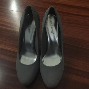 Grey pumps with metal embellishment at back