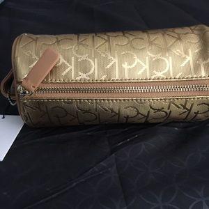 Authentic Calvin Klein cosmetics makeup bag. Gold