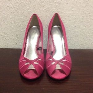 Pink open toed high heeled shoes