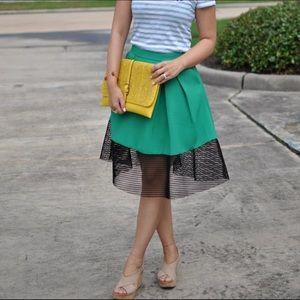 Green midi skirt with black trim. Worn once!