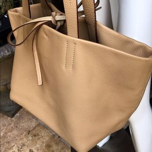 Prada tan pebbled leather tote