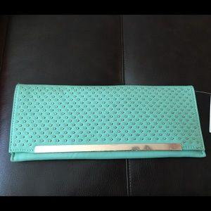 Mint studded clutch purse