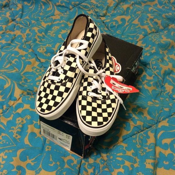 black and grey checkerboard vans lace up