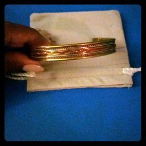 Mixed metal adjustable bracelet