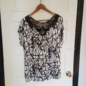 Cute black/white top with lace back.