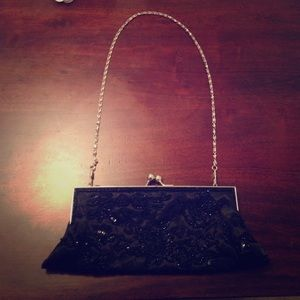 Little black beaded clutch with silver hardware
