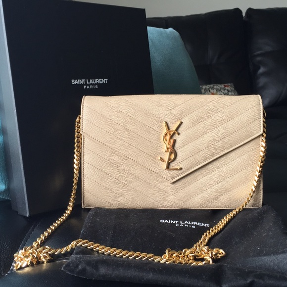 Authentic Cream colored YSL clutch. M 55fcc4e0522b453d8c0044dc bfb657be7ddf6