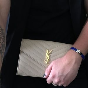 f07105faee Yves Saint Laurent Bags - Authentic Cream colored YSL clutch