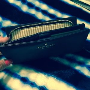 Kate spade purple wallet.