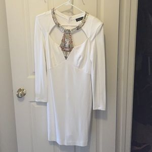 Cream cut out dress with sequin neck accent.