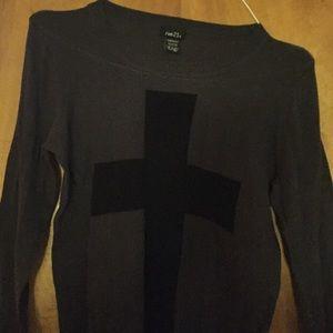 Grey sweater with black cross .