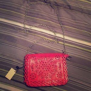 Handbags - NWT laser cut CROSSBODY purse