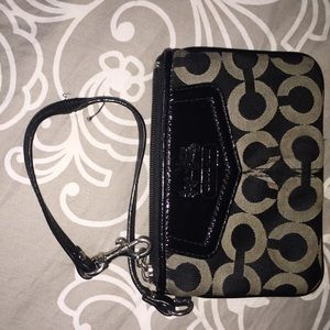 Silver and black Coach wristlet