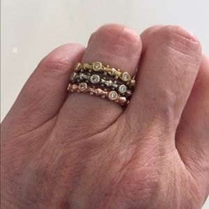 Set of 3 - 14K gold and diamond stacking rings.