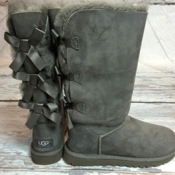 Grey Tall Uggs with bows on the back!
