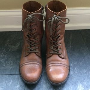 Brown combat boots. Always worn with socks!