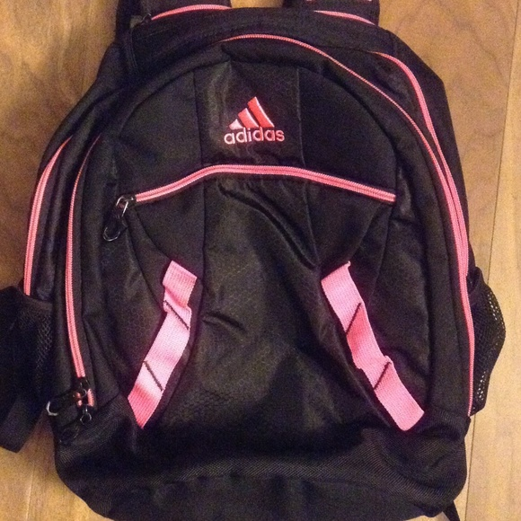 fc9f1e6cc3 Adidas Handbags - Black Adidas backpack with pink zippers 💗💗💗