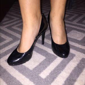 Black round toe pumps
