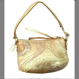 Auth Coach metalics wave hobo bag