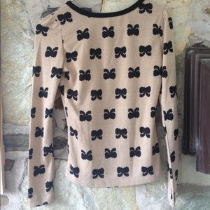 Charlotte Russe Sweaters - Charlotte Russe tan sweater w/ black bows. Sz xs