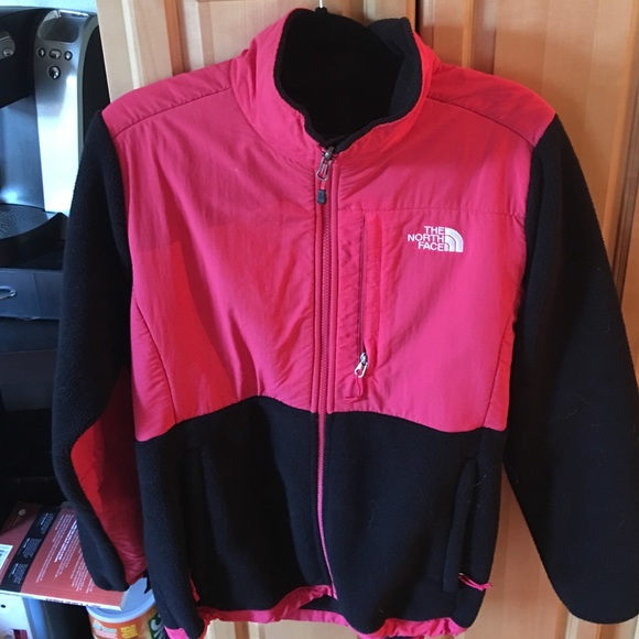 Pink and black north face jacket