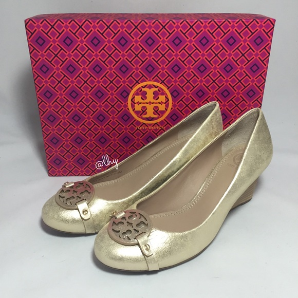ad933566366 TORY BURCH MINI MILLER WEDGE PUMPS - GOLD. M 560ef602291a35d705002e12