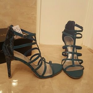 Christian Siriano Shoes - Sexy Turquoise heels with snake print heel back