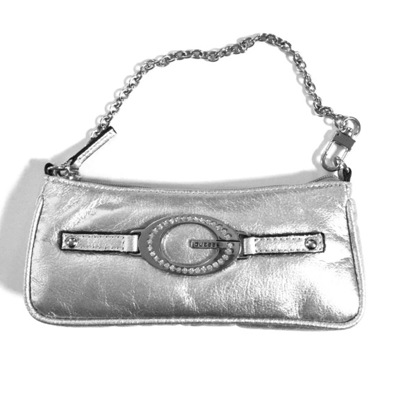4b20f2046c Guess Handbags - Silver metallic tiny Guess clutch purse with chain