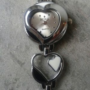 Ladies stainless steel heart shaped watch