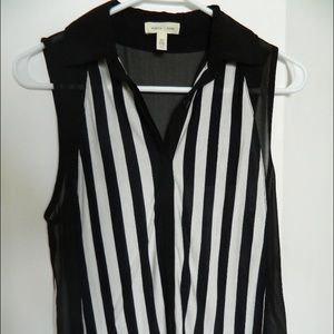 NWOT. White and black stripe sleeveless shirt.