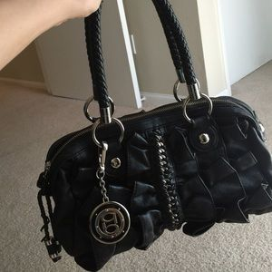 Black purse with Bebe chain