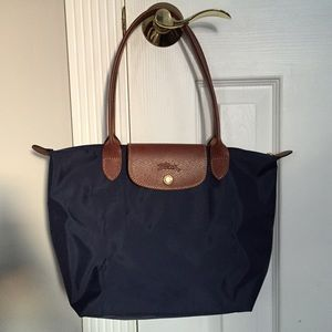 Longchamp Handbags - Brand NEW, authentic Longchamp Le Pliage in Navy.