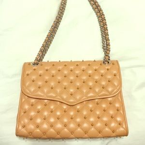 Rebecca Minkoff studded quilted blush handbag.