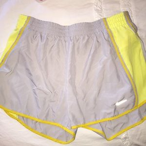 women's M yellow and grey Nike shorts