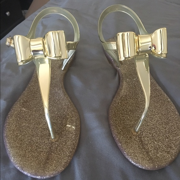 c3f9bc2f7527 BCBGeneration Shoes - BCBGeneration Demee gold jelly sandals with bow