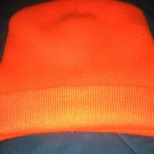 A neon orange beanie never worn