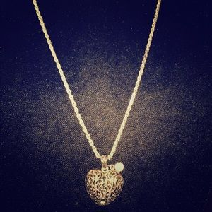 Jewelry - Silver tone long heart necklace w dangling crystal