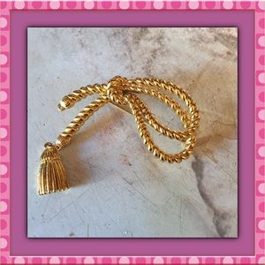 Gold tone bow brooch