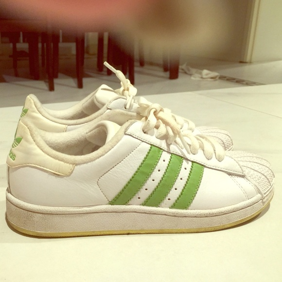 huge selection of 10bfd 49a95 Adidas Shoes - Adidas superstars with green stripes
