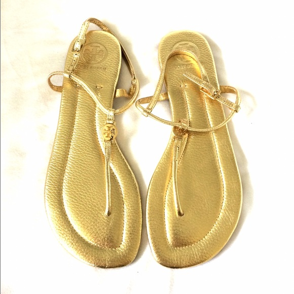 e0cfbd799ef5ee Tory Burch Emmy Metallic Thong Sandals in Gold. M 565b3f85b4188efb9302a5d5