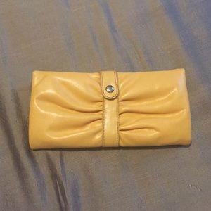 Yellow snap close wallet