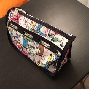 29e00606f2 LeSportsac Bags - LeSportsac Alice in Wonderland makeup bag!