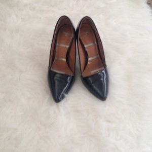 Black pointed toe heels