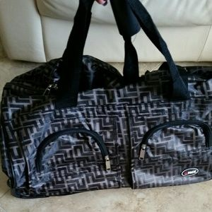 Brand new carry on duffle bag with wheels