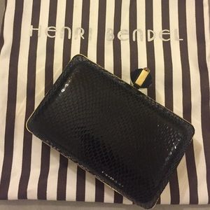 Henri Bendel Black and Gold Snakeskin Clutch