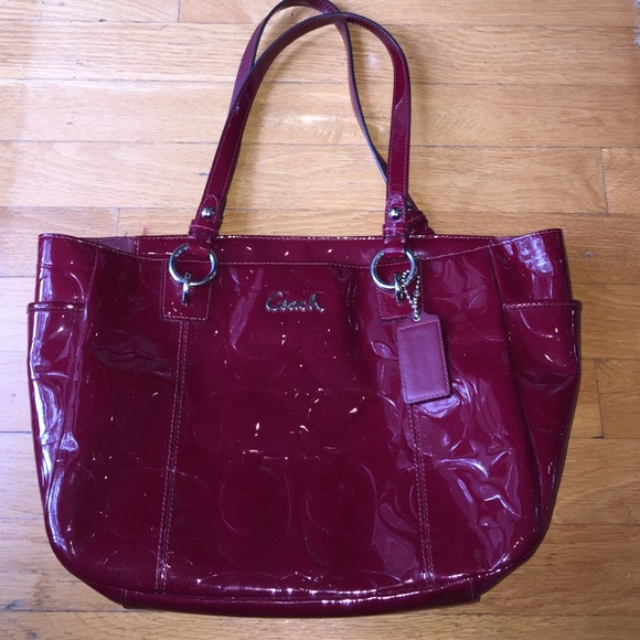 leather and wine 67 off coach handbags coach wine red embossed c patent leather