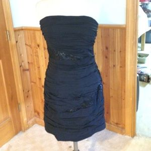 Black silk and embellished ruched cocktail dress.